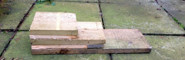 The pieces constructed in the last image are placed, one on top of the other, with the smallest at the top and the largest (the backboard) at the bottom to create the two cavities which will form the roosting sites for the bats. These are drilled securely together.
