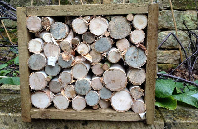 The logs stacked inside a simple wooden frame made from offcuts of wood. It took a while to arrange them all in a stable manner but a sturdy frame allows you to hammer in additional smaller pieces to pack the logs in, using the tension of the frame to hold them in place.
