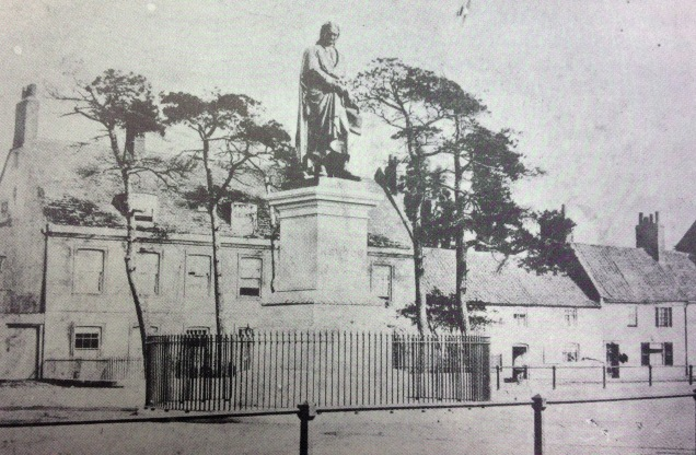 The Isaac Newton statue on St Peter's Hill in its setting before the Guildhall was built