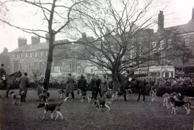The Belvoir Hunt on their annual boxing day meet-up at the top of St Peter's Hill with the Copper Beech in the background